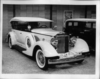 1934 Packard sport phaeton, three-quarter front view, top raised