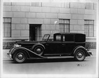 1934 Packard Rollston town car, nine-tenths left side view, parked on street