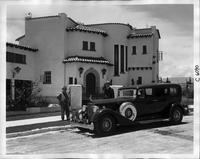 1934 Packard sedan limousine, parked in front of large southwestern style home