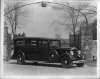 1934 Packard funeral coach at gate to Packard Proving Grounds