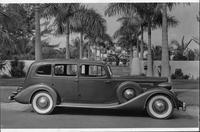 1935 Packard sedan, right side view, parked on street