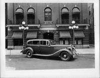 1935 Packard commercial sedan, nine-tenths right side view, parked on city street