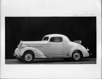 1935 Packard sport coupe, nine-tenths left side view, rumble seat open
