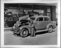 1935 Packard touring coupe, Mr. Harry S. Trinkle looking under hood