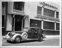 1935 Packard limousine parked in front of La Consolidada S.A.