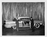 1955 Packard Clipper Constellation on display with man and woman