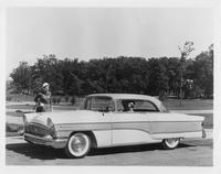 1956 Packard Clipper, woman behind wheel, woman standing at front of car