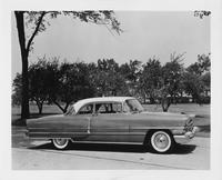 1956 Packard sedan, right side view, parked on drive