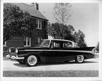 1958 Packard sedan, nine-tenths left side view, parked in driveway, house in background