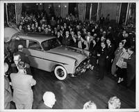 1950 Packard 4-door sedan admired by crowd at automobile show
