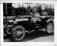 Actresses Polly Moran and Anita Page on Hollywood movie set in a 1908 Packard runabout
