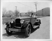 Actress Leatrice Joy behind wheel of1925-26 Packard runabout