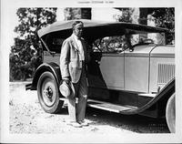Clifford Walker, governor of Georgia, next to his 1927 Packard phaeton