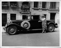 Opera singer Anna Case standing next to her 1930 Packard convertible coupe