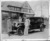 Comic strip creator Russ Westover takes delivery of his 1930 Packard sedan from salesman Ed Bennett