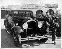 Benito Corona with foot on bumper of his 1930 Packard sedan