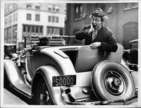 Ed Wynn in the rumble seat of his 1932 Packard coupe roadster