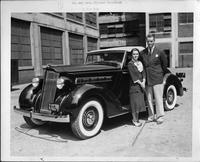 Mr. and Mrs. Elliott Roosevelt taking delivery of 1935 Packard 120 convertible coupe