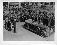 Aviator Amelia Earhart participating in Brooklyn Day opening ceremonies, with 1935 Packard phaeton