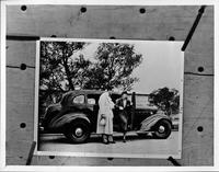 Onslow Stevens helping Evalyn Knapp out of 1936 Packard touring sedan