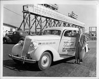 Race car driver Wilbur Shaw with 1936 Packard touring sedan at Indianapolis Motor Speedway, Memorial Day, 1936