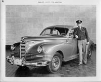 1946-47 Packard touring sedan, three-quarter left front view, with owner General Arnold standing at driver door