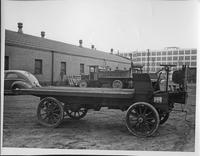 "1904 Packard ""3"" experimental truck, right side view, parked in yard near Packard factory"