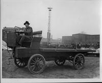 1910 Packard truck, left side view, man in driver seat