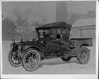 1910 Packard truck, seven-eights left side view, top raised, side curtains in place