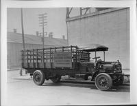 1917 Packard truck, nine-tenths right side view, parked on street