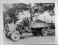 1917-18 Packard dump truck, left side view, hauling a load of dirt