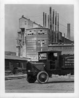 1918-19 Packard truck, nine-tenths left side view, factory in background