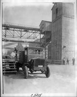 1919 Packard truck, front view, factory in background