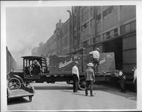 1921-22 Packard truck, left side view, unloading Packard crates into boxcars