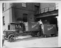 1921-22 Packard truck, left side view, hauling Packard crates