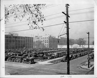 Packard factory parking yard full of models