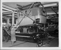 1928 Packard club sedan body being lowered on to chassis at final assembly