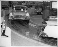 Three 1955 Packards on final assembly line