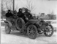 1908 Packard model U test car, three-quarter front left view, covered in mud with four male passengers
