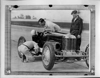 Inauguration of the Packard proving grounds, race car being checked on track