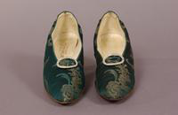 Women's brocaded, green satin pumps from the early twentieth century