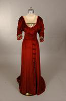 Red gown with lace yoke from the early twentieth century