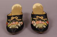 Women's black satin mules from the 1920s