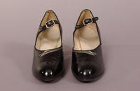 Women's black patent leather shoes with a strap from the mid '20s or early '30s