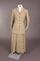 Women's  suit with divided skirt and matching jacket of tan linen from the early twentieth century