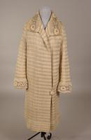 Women's coat with strips of white wool yarn and white silk floss from the 1920s