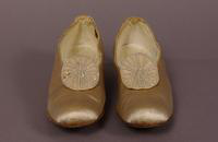 Women's cream-color satin pumps from the early twentieth century