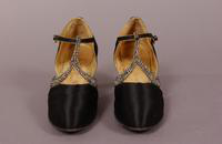Women's black satin shoes from the 1920s