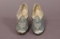 Women's ice blue satin pumps with glass bead trim from the early twentieth century