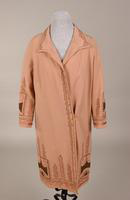 Women's evening coat with elaborate pink and gold braid trim from the 1920s